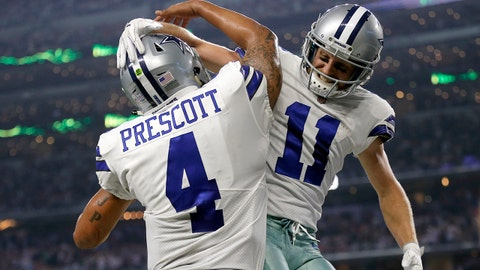 Dallas Cowboys' Dak Prescott (4) and Cole Beasley (11) celebrate a touchdown scored on a passing play by Beasley in the second half of an NFL football game against the Kansas City Chiefs on Sunday, Nov. 5, 2017, in Arlington, Texas. (AP Photo/Brandon Wade)