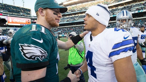 Jan 1, 2017; Philadelphia, PA, USA; Philadelphia Eagles quarterback Carson Wentz (11) and Dallas Cowboys quarterback Dak Prescott (4) meet on the field after a game at Lincoln Financial Field. The Philadelphia Eagles won 27-13. Mandatory Credit: Bill Streicher-USA TODAY Sports