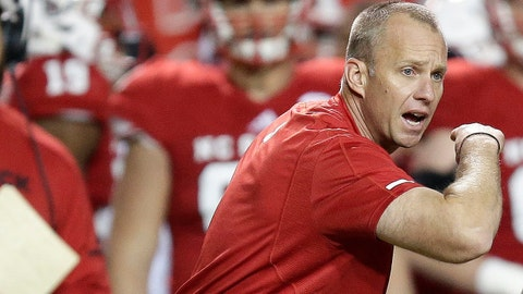 North Carolina State head coach Dave Doeren reacts with Joshua Fedd-Jackson (66) and Garrett Bradbury (65) following a play during the second half of an NCAA college football game against North Carolina in Raleigh, N.C., Saturday, Nov. 25, 2017. (AP Photo/Gerry Broome)