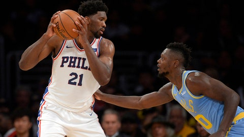 November 15, 2017; Los Angeles, CA, USA; Philadelphia 76ers center Joel Embiid (21) controls the ball against Los Angeles Lakers forward Julius Randle (30) during the second half at Staples Center. Mandatory Credit: Gary A. Vasquez-USA TODAY Sports