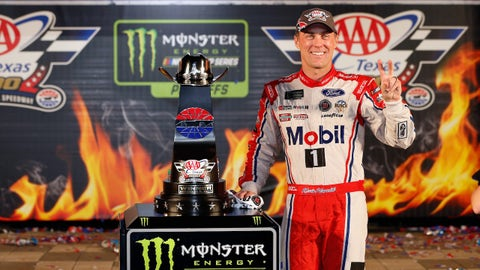 FORT WORTH, TX - NOVEMBER 05:  Kevin Harvick, driver of the #4 Mobil 1 Ford, poses with the trophy in Victory Lane after winning the Monster Energy NASCAR Cup Series AAA Texas 500 at Texas Motor Speedway on November 5, 2017 in Fort Worth, Texas.  (Photo by Brian Lawdermilk/Getty Images)