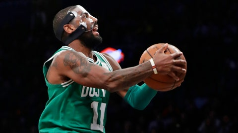 Boston Celtics' Kyrie Irving (11) drives to the basket during the second half of an NBA basketball game against the Brooklyn Nets on Tuesday, Nov. 14, 2017, in New York. The Celtics won 109-102. (AP Photo/Frank Franklin II)