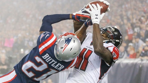 Oct 22, 2017; Foxborough, MA, USA; New England Patriots cornerback Malcolm Butler (21) attempts to intercept a pass intended for Atlanta Falcons wide receiver Julio Jones (11) during the second half at Gillette Stadium. Mandatory Credit: Greg M. Cooper-USA TODAY Sports
