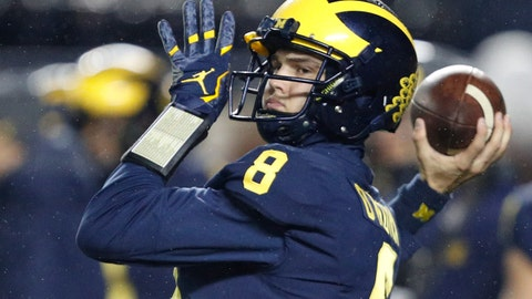 Nov 4, 2017; Ann Arbor, MI, USA; Michigan Wolverines quarterback John O'Korn (8) throws the ball during warm ups before the game against the Minnesota Golden Gophers at Michigan Stadium. Mandatory Credit: Raj Mehta-USA TODAY Sports