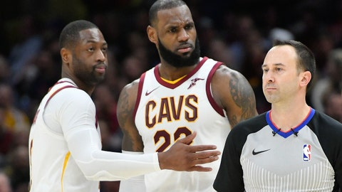 Nov 28, 2017; Cleveland, OH, USA; Cleveland Cavaliers forward LeBron James (23) reacts with Dwyane Wade (9) after he was ejected by referee Kane Fitzgerald (5) in the third quarter against the Miami Heat at Quicken Loans Arena. Mandatory Credit: David Richard-USA TODAY Sports