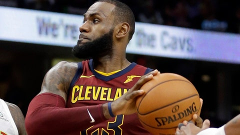 Cleveland Cavaliers' LeBron James (23) drives against Atlanta Hawks' Taurean Prince (12) and Kent Bazemore (24) in the second half of an NBA basketball game, Sunday, Nov. 5, 2017, in Cleveland. (AP Photo/Tony Dejak)