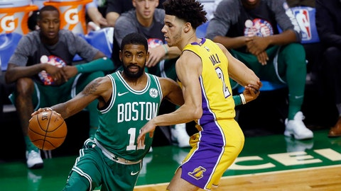 Boston Celtics' Kyrie Irving drives past Los Angeles Lakers' Lonzo Ball during the first quarter of an NBA basketball game in Boston on Wednesday, Nov. 8, 2017. (AP Photo/Winslow Townson)
