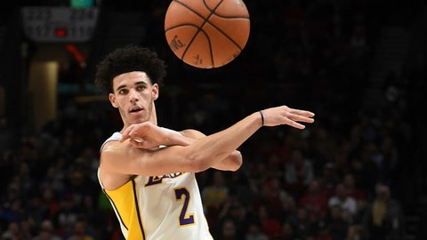Los Angeles Lakers guard Lonzo Ball passes the ball during the first quarter of the team's NBA basketball game against the Portland Trail Blazers in Portland, Ore., Thursday, Nov. 2, 2017. (AP Photo/Steve Dykes)