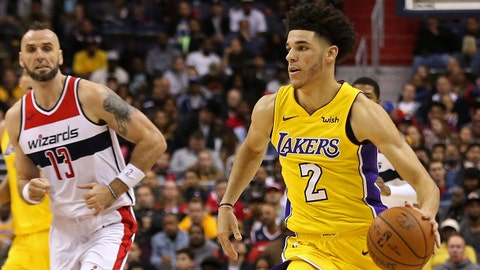 Nov 9, 2017; Washington, DC, USA; Los Angeles Lakers guard Lonzo Ball (2) dribbles the ball as Washington Wizards center Marcin Gortat (13) chases in the third quarter at Capital One Arena. The Wizards won 111-95. Mandatory Credit: Geoff Burke-USA TODAY Sports