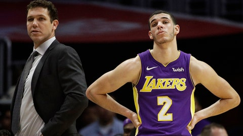 Los Angeles Lakers head coach Luke Walton, left, and Lonzo Ball watch action during the second half of an NBA basketball game against the Los Angeles Clippers, Monday, Nov. 27, 2017, in Los Angeles. The Clippers 120-115. (AP Photo/Jae C. Hong)