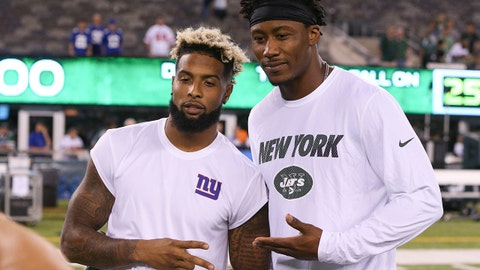 Aug 27, 2016; East Rutherford, NJ, USA; New York Giants wide receiver Odell Beckham (left) and New York Jets wide receiver Brandon Marshall (right) pose for a photo after a preseason game at MetLife Stadium. The Giants won, 21-20.  Mandatory Credit: Vincent Carchietta-USA TODAY Sports