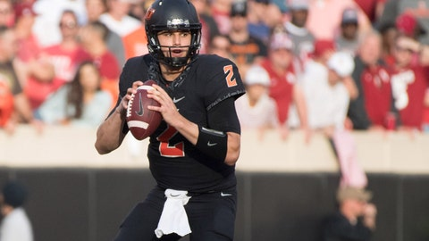 Nov 4, 2017; Stillwater, OK, USA; Oklahoma State Cowboys quarterback Mason Rudolph (2) looks to pass during the second half against the Oklahoma Sooners at Boone Pickens Stadium. Mandatory Credit: Rob Ferguson-USA TODAY Sports