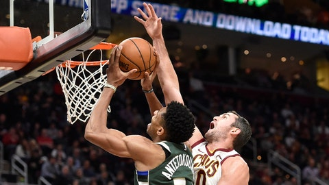 Nov 7, 2017; Cleveland, OH, USA; Milwaukee Bucks forward Giannis Antetokounmpo (34) shoots the ball past Cleveland Cavaliers forward Kevin Love (0) in the third quarter at Quicken Loans Arena. Mandatory Credit: David Richard-USA TODAY Sports