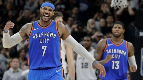 Oklahoma City Thunder forward Carmelo Anthony (7) reacts after scoring against the San Antonio Spurs during the second half of an NBA basketball game, Friday, Nov. 17, 2017, in San Antonio. Anthony thought he had made a 3-point basket, but it was ruled a 2-pointer. San Antonio won 104-101. (AP Photo/Eric Gay)