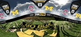"""Michigan runs under the """"Go Blue"""" banner before facing off against Ohio State 