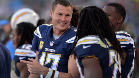 Nov 19, 2017; Carson, CA, USA; Los Angeles Chargers quarterback Philip Rivers (17) smiles as he talks to running back Melvin Gordon (28) during the fourth quarter at StubHub Center. Mandatory Credit: Jake Roth-USA TODAY Sports