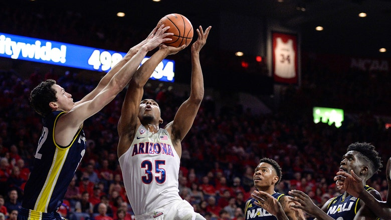 Trier scores career-high 32, No. 3 Wildcats open with rout NAU