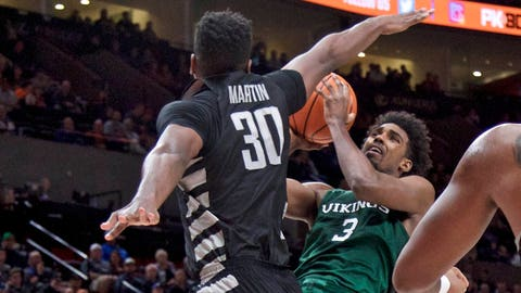 Portland State guard Deontae North, right, shoots over Butler forward Kelan Martin during the second half of an NCAA college basketball game in the Phil Knight Invitational tournament in Portland, Ore., Friday, Nov. 24, 2017. (AP Photo/Craig Mitchelldyer)
