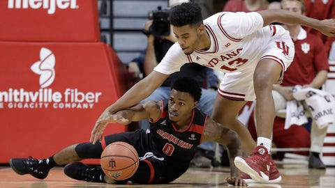 Arkansas State's Ty Cockfield and Indiana's Juwan Morgan reach for a loose ball during the second half of an NCAA college basketball game, Wednesday, Nov. 22, 2017, in Bloomington, Ind. Indiana won 87-70. (AP Photo/Darron Cummings)