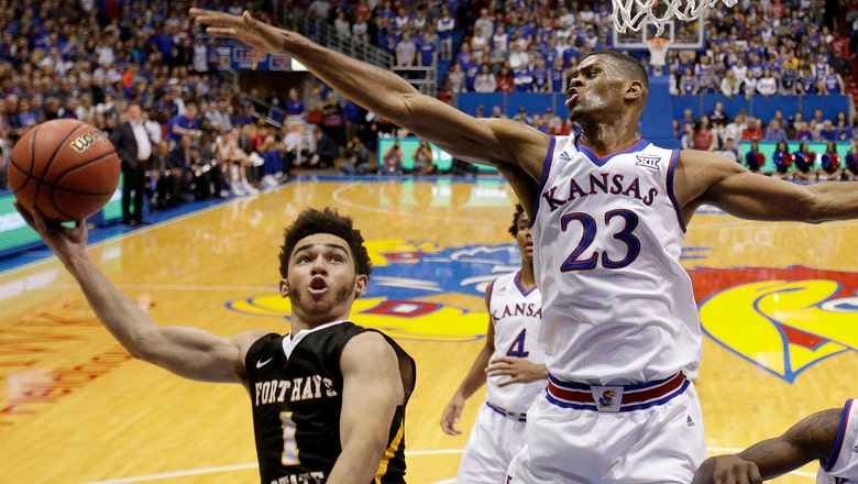Preston sits for No. 4 Kansas as investigation into on-campus incident continues