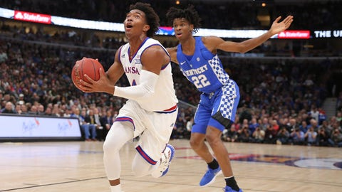Nov 14, 2017; Chicago, IL, USA; Kansas Jayhawks guard Devonte' Graham (4) drives past Kentucky Wildcats guard Shai Gilgeous-Alexander (22) during the first half at United Center. Mandatory Credit: Dennis Wierzbicki-USA TODAY Sports