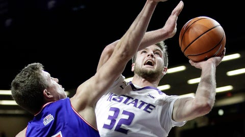 Kansas State's Dean Wade (32) shoots under pressure from American University's Larry Motuzis (5) during the first half of an NCAA college basketball game, Friday, Nov. 10, 2017, in Manhattan, Kan. (AP Photo/Charlie Riedel)