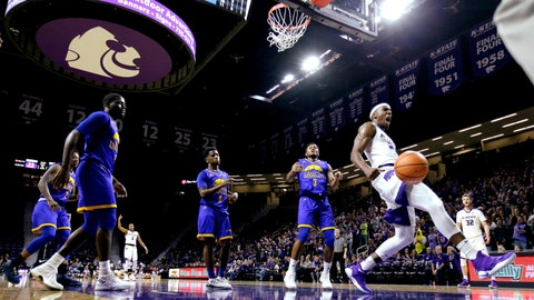 Kansas State's Xavier Sneed (20) celebrates after a dunk during the first half of an NCAA college basketball game against UKMC, Tuesday, Nov. 14, 2017, in Manhattan, Kan. (AP Photo/Charlie Riedel)
