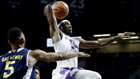 Kansas State's Xavier Sneed (20) gets past UC Irvine's Jonathan Galloway (5) to put up a shot during the first half of an NCAA college basketball game, Friday, Nov. 17, 2017, in Manhattan, Kan. Kansas State won 71-49. (AP Photo/Charlie Riedel)