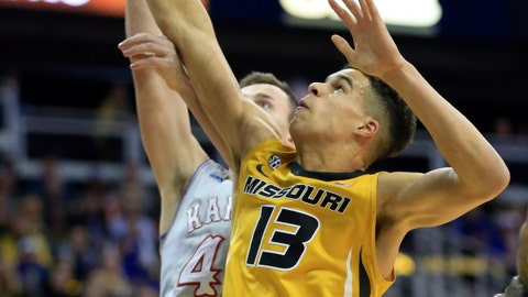 FILE - In this Oct. 22, 2017, file photo, Missouri forward Michael Porter Jr. rebounds during the first half of an exhibition NCAA college basketball game against Kansas in Kansas City, Mo. Porter was selected to The Associated Press preseason All-America team on Monday, Nov. 6, 2017. (AP Photo/Orlin Wagner, File)