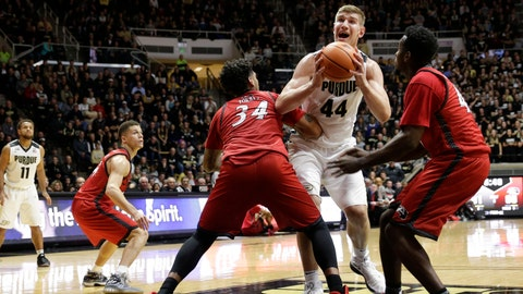 Purdue center Isaac Haas (44) tries to get between SIU-Edwardsville defenders Julian Torres, left, and Keenan Simmons in the second half of an NCAA college basketball game in West Lafayette, Ind., Friday, Nov. 10, 2017. (AP Photo/AJ Mast)