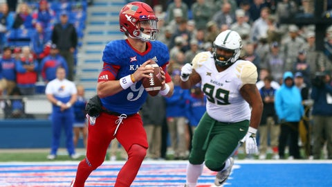 Nov 4, 2017; Lawrence, KS, USA; Kansas Jayhawks quarterback Carter Stanley (9) rolls out to pass as Baylor Bears defensive tackle Bravvion Roy (99) defends in the first half at Memorial Stadium. Mandatory Credit: Jay Biggerstaff-USA TODAY Sports