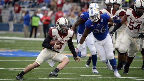 Oct 31, 2015; Lawrence, KS, USA; Oklahoma Sooners quarterback Baker Mayfield (6) is pressured by Kansas Jayhawks defensive tackle Daniel Wise (96) in the first half at Memorial Stadium. Mandatory Credit: John Rieger-USA TODAY Sports