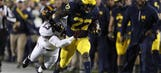 Higdon, Wolverines run wild in Gophers' 33-10 loss
