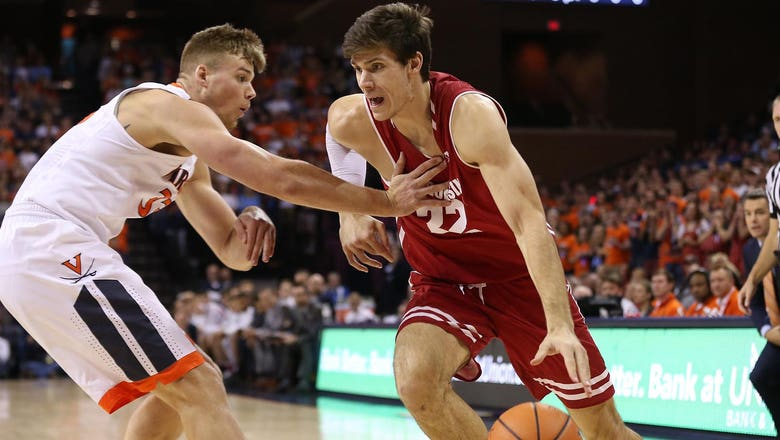 Badgers suffocated by Virginia in defensive battle, 49-37