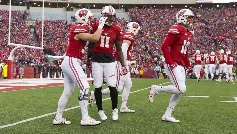 Badgers break open defensive battle, top Michigan 24-10