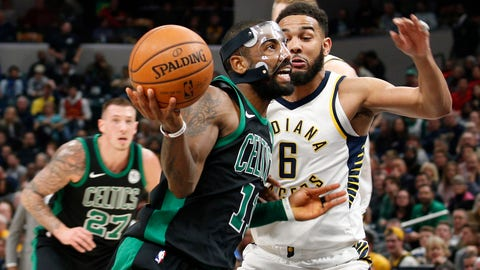 Nov 25, 2017; Indianapolis, IN, USA; Boston Celtics guard Kyrie Irving (11) drives to the basket against Indiana Pacers guard Cory Joseph (6) in the fourth quarter at Bankers Life Fieldhouse. Mandatory Credit: Brian Spurlock-USA TODAY Sports