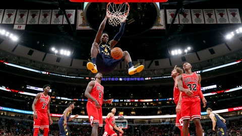 Indiana Pacers guard Victor Oladipo (4) dunks the basketball against the Chicago Bulls during the second half of an NBA basketball game in Chicago, on Friday Nov. 10, 2017. (AP Photo/Jeff Haynes)