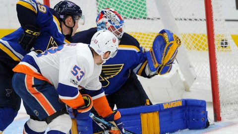 New York Islanders' Casey Cizikas (53) scores on St. Louis Blues goalie Jake Allen and Vince Dunn (29) during the first period of an NHL hockey game, Saturday, Nov. 11, 2017, in St. Louis. (AP Photo/Bill Boyce)