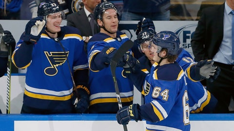 Nov 25, 2017; St. Louis, MO, USA;  St. Louis Blues left wing Sammy Blais (64) is congratulated by teammates after scoring a goal against the Minnesota Wild during the third period at Scottrade Center. Mandatory Credit: Scott Kane-USA TODAY Sports
