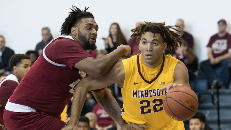 Minnesota routs Massachusetts 69-51 in Barclays Classic opener