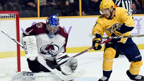 Colorado Avalanche goalie Semyon Varlamov (1) blocks a shot by Nashville Predators left wing Viktor Arvidsson (33), of Sweden, during the second period of an NHL hockey game, Saturday, Nov. 18, 2017, in Nashville, Tenn. (AP Photo/Mark Zaleski)