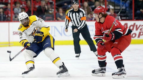 Nashville Predators' P.K. Subban (76) passes as Carolina Hurricanes' Brock McGinn (23) defends during the first period of an NHL hockey game in Raleigh, N.C., Sunday, Nov. 26, 2017. (AP Photo/Gerry Broome)