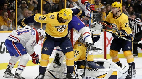 Montreal Canadiens left wing Nicholas Deslauriers ends up on top of the net after battling for the puck with Nashville Predators defenseman P.K. Subban (76); goalie Pekka Rinne (35), of Finland; and defenseman Alexei Emelin (25), of Russia, during the third period of an NHL hockey game Wednesday, Nov. 22, 2017, in Nashville, Tenn. (AP Photo/Mark Humphrey)