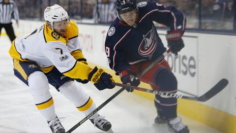Nashville Predators' Yannick Weber, left, of Switzerland, knocks the puck away from Columbus Blue Jackets' Artemi Panarin, of Russia, during the second period of an NHL hockey game Tuesday, Nov. 7, 2017, in Columbus, Ohio. (AP Photo/Jay LaPrete)