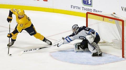 Nashville Predators defenseman Nick Bonino (13) scores a goal against Winnipeg Jets goalie Connor Hellebuyck (37) in the third period of an NHL hockey game, Monday, Nov. 20, 2017, in Nashville, Tenn. The Predators won 5-3. (AP Photo/Mark Humphrey)
