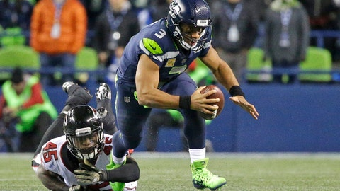 Seattle Seahawks quarterback Russell Wilson (3) is tripped up by Atlanta Falcons middle linebacker Deion Jones (45) as he scrambles in the second half of an NFL football game, Monday, Nov. 20, 2017, in Seattle. The Falcons won 34-31. (AP Photo/Ted S. Warren)
