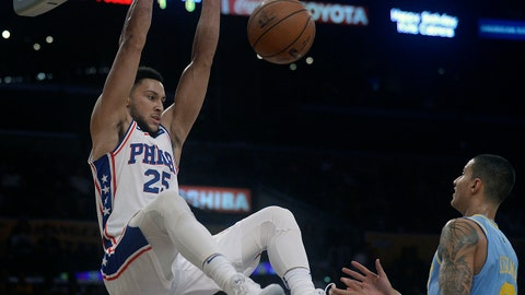 November 15, 2017; Los Angeles, CA, USA; Philadelphia 76ers guard Ben Simmons (25) dunks to score a basket in front of Los Angeles Lakers forward Kyle Kuzma (0) during the first half at Staples Center. Mandatory Credit: Gary A. Vasquez-USA TODAY Sports