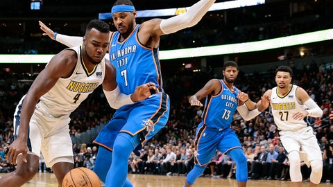Nov 9, 2017; Denver, CO, USA; Denver Nuggets forward Paul Millsap (4) drives to the basket against Oklahoma City Thunder forward Carmelo Anthony (7) in the first quarter at the Pepsi Center. Mandatory Credit: Isaiah J. Downing-USA TODAY Sports