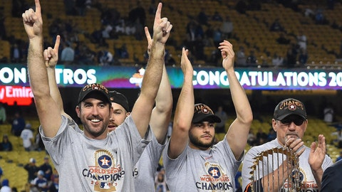 Nov 1, 2017; Los Angeles, CA, USA; Houston Astros pitcher Justin Verlander (left) and teammates celebrate after defeating the Los Angeles Dodgers in game seven of the 2017 World Series at Dodger Stadium. Mandatory Credit: Jayne Kamin-Oncea-USA TODAY Sports