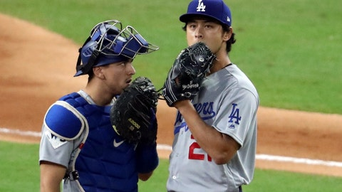 Oct 27, 2017; Houston, TX, USA; Los Angeles Dodgers starting pitcher Yu Darvish (21) talks with catcher Austin Barnes in the first inning against the Houston Astros in game three of the 2017 World Series at Minute Maid Park. Mandatory Credit: Matthew Emmons-USA TODAY Sports